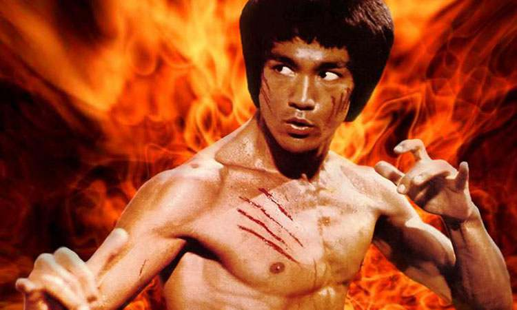 bruce lee with fire behind him