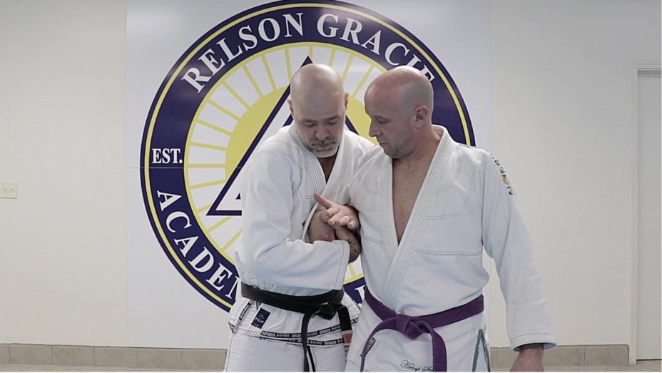 martial artist with opponent in a wrist lock