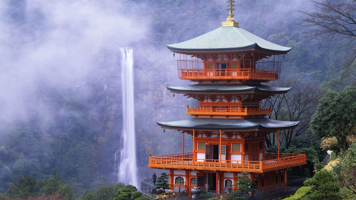 temple on top of a mountain with waterfall in background